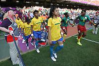 The teams take to the field - Brazil Women vs Cameroon Women - Womens Olympic Football Tournament London 2012 Group E at the Millenium Stadium, Cardiff, Wales - 25/07/12 - MANDATORY CREDIT: Gavin Ellis/SHEKICKS/TGSPHOTO - Self billing applies where appropriate - 0845 094 6026 - contact@tgsphoto.co.uk - NO UNPAID USE.