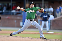 Savannah Sand Gnats starting pitcher Logan Taylor #33 delivers a pitch during a game against the Asheville Tourists at McCormick Field July 16, 2014 in Asheville, North Carolina. The Tourists defeated the Sand Gnats 6-3. (Tony Farlow/Four Seam Images)