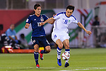 Otabek Shukurov of Uzbekistan (R) competes for the ball with Muto Yoshinori of Japan (L) during the AFC Asian Cup UAE 2019 Group F match between Japan (JPN) and Uzbekistan (UZB) at Khalifa Bin Zayed Stadium on 17 January 2019 in Al Ain, United Arab Emirates. Photo by Marcio Rodrigo Machado / Power Sport Images