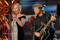 Pennsylvania's First Lady Judge Midge Rendell, left, sings a duet with rock star Jon Bon Jovi, right, at Gov. Ed Rendell's Inaugural Ball Tuesday, Jan. 16, 2006 in Harrisburg, Pa. Rendell, Pennsylvania's 45th governor, was sworn in by his wife, Midge, a federal judge, administered his oath in a ceremony on the Statehouse steps. (AP Photo/Bradley C Bower)