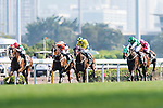 Brazilian jockey Joao Moreira (L) riding Neorealism crosses the finish line to win the Audemars Piguet QEII Cup horse race at Sha Tin race course in Hong Kong, China. (Photo by Marcio Rodrigo Machado / Power Sport Images)
