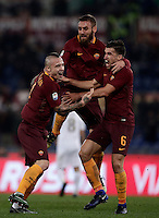 Calcio, Serie A: Roma vs Milan. Roma, stadio Olimpico, 12 dicembre 2016.<br /> Roma's Radja Nainggolan, left, celebrates  with teammates Daniele De Rossi, center, and Kevin Strootman, after scoring during the Italian Serie A football match between Roma and AC Milan at Rome's Olympic stadium, 12 December 2016.<br /> UPDATE IMAGES PRESS/Isabella Bonotto