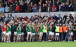 Kilmurry Ibrickane stand for the anthem before their senior county final against Clondegad at Cusack park. Photograph by John Kelly.