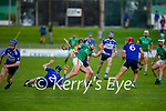 Ballyduffs Dylan Moriarty in possession as he is been well shadowed by the St Brendan's defenders in round 2 of the County Hurling Championship
