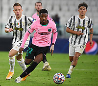 Football Soccer: UEFA Champions League -Group Stage-  Group G - Juventus vs FC Barcellona, Allianz Stadium. Turin, Italy, October 28, 2020.<br /> Barcellona's Ansu Fati (c) in action with Juventus' Arthur   (l) and Paulo Dybala (r) during the Uefa Champions League football soccer match between Juventus and Barcellona at Allianz Stadium in Turin, October 28, 2020.<br /> UPDATE IMAGES PRESS/Isabella Bonotto