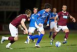 Hearts v St Johnstone...14.02.12.. Scottish Cup 5th Round Replay.Fran Sandaza gets between Danny Grainger and Mehdi Taouil.Picture by Graeme Hart..Copyright Perthshire Picture Agency.Tel: 01738 623350  Mobile: 07990 594431