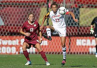 COLLEGE PARK, MD - OCTOBER 21, 2012:  Alexis Prior-Brown (23) of the University of Maryland knocks the ball away from Kristin Grubka (13) of Florida State during an ACC women's match at Ludwig Field in College Park, MD. on October 21. Florida won 1-0.