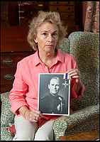 BNPS.co.uk (01202 558833)<br /> Pic: PhilYeomans/BNPS<br /> <br /> Demanding answers - Susan Bond, with picture of her father Brig Peter Curtis MC - her father and grandfathers gallantry medals have disappeared.<br /> <br /> Military museum in hot water over missing medals..<br /> <br /> A woman whose father and grandfather donated their highly-valuable gallantry medals to an army museum is furious they have disappeared having been suspiciously substituted for duplicates.<br /> <br /> Susan Bond, whose husband Richard is a retired crown court judge, discovered the two Military Cross groups at the The Royal Green Jackets Museum are not the ones bequeathed to them after one set appeared on the open market.<br /> <br /> Mrs Bond confronted the trustees at the museum, whose former Colonel-in-Chief was the Queen, but the 70-year-old has been left dismayed at their 'indifferent' response at the loss which they have been unable to properly explain.<br /> <br /> The owners - the museum based in Winchester, Hants - said they were satisfied that no criminal activity had taken place and the police investigation came to nothing.