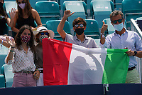 4th April 2021; Miami Gardens, Miami, Florida, USA;  Fans wave flags during the mens finals match of the Miami Open on April 4, 2021, at Hard Rock Stadium in Miami Gardens, Florida