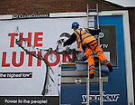 © Joel Goodman - 07973 332324 .  12/01/2015 . Salford , UK . A man pastes up the campaign billboard . Bez ( Mark Berry ) launches his parliamentary campaign for the constituency of Salford and Eccles at a poster site on Chapel Street , Salford . Bez , the freaky dancer from Madchester band The Happy Mondays , is standing for The Reality Party . Seat incumbent , Labour's Hazel Blears , is standing down at the 2015 election . Photo credit : Joel Goodman