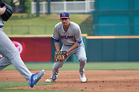Midland RockHounds first baseman Luke Persico (8) flips the ball to the pitcher covering during a Texas League game against the Frisco RoughRiders on May 22, 2019 at Dr Pepper Ballpark in Frisco, Texas.  (Mike Augustin/Four Seam Images)