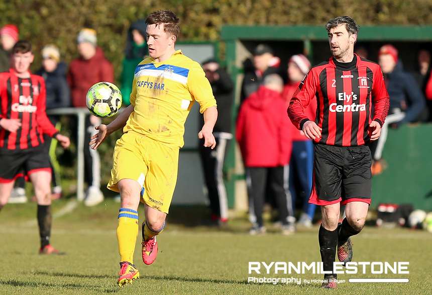 Joe Moloney of Thurles in action against Alan Leahy of Peake Villa during the Munster Junior Cup 5th Round at Tower Grounds, Thurles, Co Tipperary on Sunday 11th February 2018, Photo By Michael P Ryan