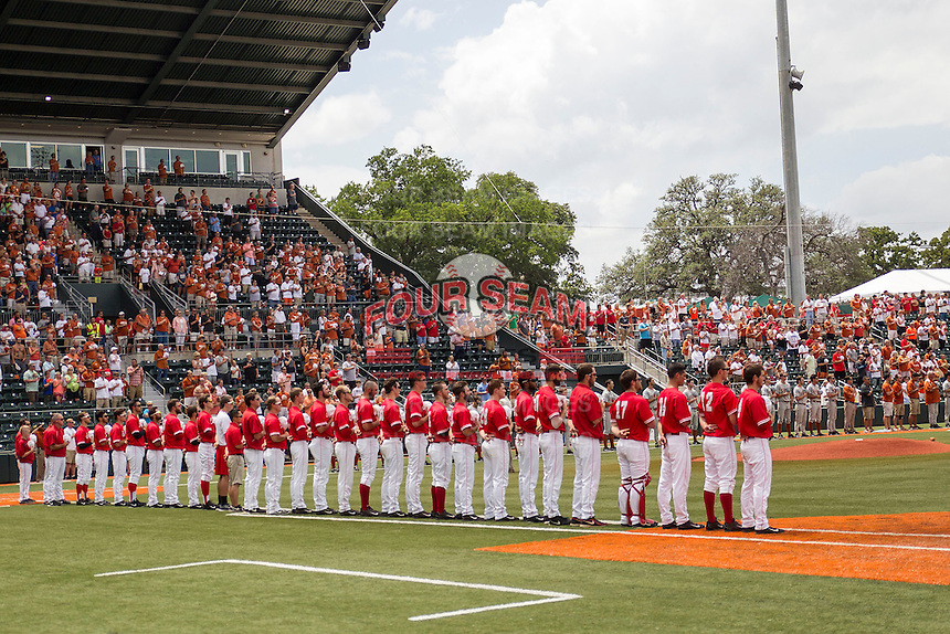 Houston Cougars and Texas Longhorns baseball teams line up during the National Anthem on June 6, 2014 at UFCU Disch–Falk Field in Austin, Texas. The Longhorns defeated the Cougars 4-2 in Game 1 of the NCAA Super Regional. (Andrew Woolley/Four Seam Images)