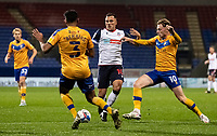 Bolton Wanderers' Antoni Sarcevic (centre) competing with Mansfield Town's George Maris (right) and Malvind Benning <br /> <br /> Photographer Andrew Kearns/CameraSport<br /> <br /> The EFL Sky Bet League Two - Bolton Wanderers v Mansfield Town - Tuesday 3rd November 2020 - University of Bolton Stadium - Bolton<br /> <br /> World Copyright © 2020 CameraSport. All rights reserved. 43 Linden Ave. Countesthorpe. Leicester. England. LE8 5PG - Tel: +44 (0) 116 277 4147 - admin@camerasport.com - www.camerasport.com