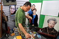 Painter Jiang Yi Ming producing original portraits in his studio. Dafen is home to an art industry producing replicas, as well as original works, of pieces by the world's great artists for sale overseas. The success of this business has attracted more and more trained artists to the town seeking an opportunity to make a living.