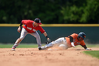 Boston Red Sox Jeremy Rivera (11) applies the tag to Hector Veloz (17) sliding into second during a minor league spring training game against the Baltimore Orioles on March 20, 2015 at Buck O'Neil Complex in Sarasota, Florida.  (Mike Janes/Four Seam Images)
