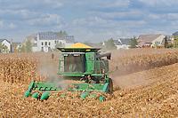Combine Harvesting a Corn Field next to a Suburban Neighborhood