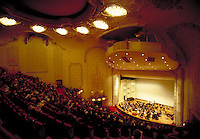 The concert hall architecture is shown in picture of Pittsburgh Symphony in Heinz Hall. Pittsburgh symphony. Pittsburgh Pennsylvania United States Heinz concert hall.