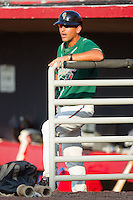 Greensboro Grasshoppers manager Andy Haines #19 watches the action during a South Atlantic League game against the Hickory Crawdads at  L.P. Frans Stadium July 10, 2010, in Hickory, North Carolina.  Photo by Brian Westerholt / Four Seam Images