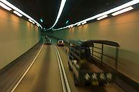 Speeding cars inside a tunnel, Hong Kong, China.