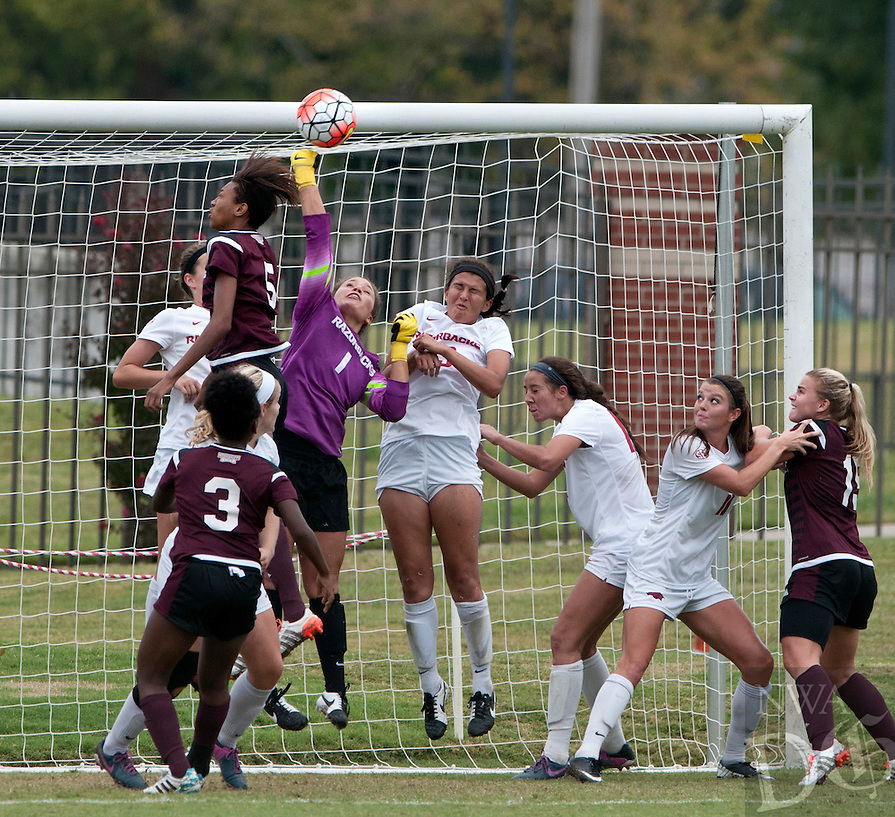 NWA Democrat-Gazette/BEN GOFF @NWABENGOFF<br /> Cameron Carter (1), Arkansas keeper, makes a save as other Arkansas player help defend the goal from a Mississippi State corner kick in the first half on Sunday Sept. 20, 2015 during the match at Razorback Field in Fayetteville.