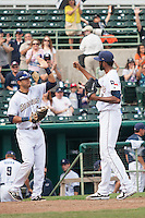 San Antonio Missions pitcher Tayron Guerrero (40) celebrates with first baseman Luis Domorom (7) after beating the Corpus Christi Hooks in the Texas League baseball game on May 10, 2015 at Nelson Wolff Stadium in San Antonio, Texas. The Missions defeated the Hooks 6-5. (Andrew Woolley/Four Seam Images)