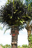 Ilheus, Bahia State, Brazil. Tourist resort south of Ilheus. amusing decorative figure of a woman made from an inverted palm tree using the roots asd hair.
