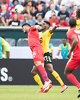 PHILADELPHIA, PA - JUNE 30: Rolando Blackburn #16 and Damion Lowe #17 go for a header during a game between Panama and Jamaica at Lincoln Financial FIeld on June 30, 2019 in Philadelphia, Pennsylvania.