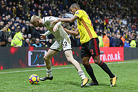 (L-R) Oliver McBurnie of Swansea City challenged by Marvin Zeegelaar of Watford during the Premier League match between Watford and Swansea City at the Vicarage Road, Watford, England, UK. Saturday 30 December 2017
