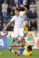 Clint Dempsey (8) of the United States (USA) goes over tackle. The men's national teams of the United States (USA) and Colombia (COL) played to a 0-0 tie during an international friendly at PPL Park in Chester, PA, on October 12, 2010.