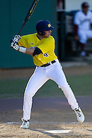 Michigan Wolverines shortstop Ramsey Romano (4) at bat during the NCAA season opening baseball game against the Texas State Bobcats on February 14, 2014 at Bobcat Ballpark in San Marcos, Texas. Texas State defeated Michigan 8-7 in 10 innings. (Andrew Woolley/Four Seam Images)