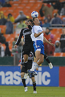 Kansas City Wizards midfielder Sasha Victorine  jumps to head the ball while cover from behind by DC United midfielder Ben Olsen (14). The Kansas City Wizards defeated DC United 4-2, in the home opening game for DC United at RFK Stadium, April 14, 2007.