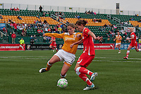 Cat Whitehill (4) of the Atlanta Beat tries to tackle Western New York's Christine Sinclair during the first half of WPS play at Sahlen's Stadium in Rochester, NY May 01, 2011. New York 3, Atlanta 0.