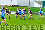 IT Tralee's Barry John Keane attempts to hand pass as he gets under pressure from Cathal Walsh of Carlow IT in the Sigerson Cup R1 football game in Austin Stack Park on Sunday.