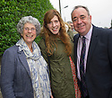 First Minister Alex Salmond gets some medication advice from Social worker Chrissie Duncan, 30, and mum Kate Duncan, 65, in Newmachar.