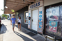 Young attractive couple walks around the East Sixth Street club scene, Eastside entertainment district in East Austin.