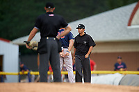 Field umpire Justin Juska listens to an argument from Luke Montz (30) as home plate umpire Mitch Trzeciak looks on during a NY-Penn League game between the Lowell Spinners and Batavia Muckdogs on July 11, 2019 at Dwyer Stadium in Batavia, New York.  Batavia defeated Lowell 5-2.  (Mike Janes/Four Seam Images)