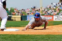New York Mets outfielder Mike Baxter #23 dives back to first on a pickoff attempt during a Spring Training game against the Detroit Tigers at Joker Marchant Stadium on March 11, 2013 in Lakeland, Florida.  New York defeated Detroit 11-0.  (Mike Janes/Four Seam Images)