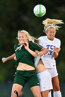 A TCU player is sandwiched between Baylor midfielder Alexa Wilde (7) and TCU forward Sarah Moghadas (3) as they attempt a header during first half of an NCAA soccer game, Friday, October 03, 2014 in Waco, Tex. TCU draw 1-1 against Baylor in double overtime. (Mo Khursheed/TFV Media via AP Images)
