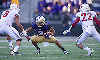 Myles Gaskin looks for room to run.  Gaskin finished with 138 yards rushing.