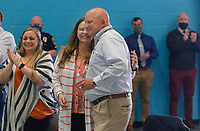 Retiring city of Rogers police chief Hayes Minor receives a hug from his wife Kim after speaking Wednesday, April 28, 2021, during a retirement reception in his honor at the Rogers Activity Center. Hayes served 27 years in law enforcement with the city and the last six as the police chief for the department. Check out nwaonline.com/210429Daily/ and nwadg.com/photos for a photo gallery.<br /> (NWA Democrat-Gazette/David Gottschalk)