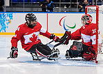 Sochi, RUSSIA - Mar 13 2014 - Steve Arsenault and Corbin Watson as Canada takes on USA in Sledge Hockey Semi-Final at the 2014 Paralympic Winter Games in Sochi, Russia.  (Photo: Matthew Murnaghan/Canadian Paralympic Committee)