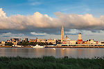 Belgium, Antwerp: Cathedral and city at sunset on bank of the River Schelde