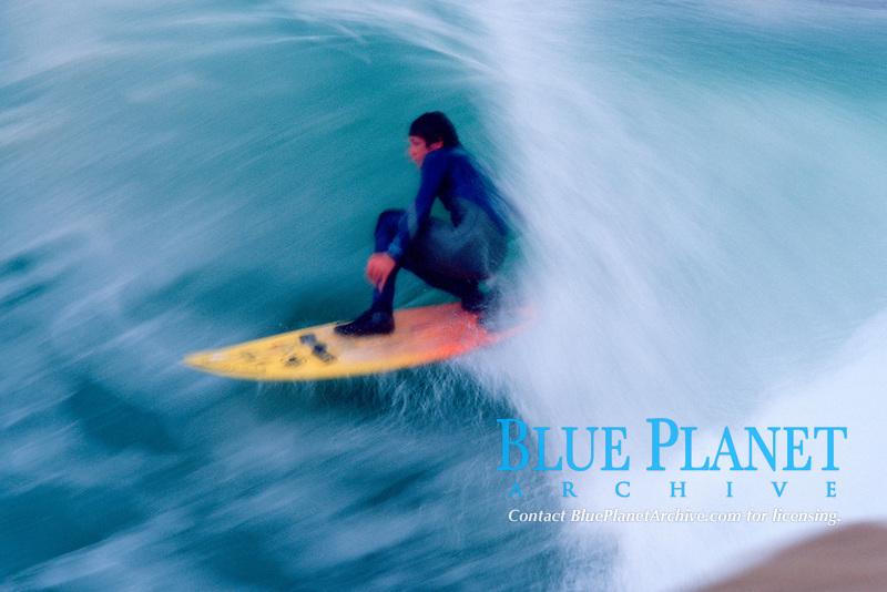 surfer having a tube ride, Scott's Creek, just south of Davenport, California, East Pacific Ocean