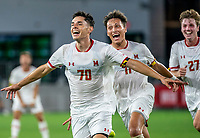 WASHINGTON, DC - SEPTEMBER 6: Maryland midfielder Malcolm Johnston (11) and midfielder Griffin Sillon (27) chases after goalscorer midfielder Brayon Padilla (70) during a game between University of Virginia and University of Maryland at Audi Field on September 6, 2021 in Washington, DC.