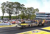 May 31, 2013; Englishtown, NJ, USA: NHRA top fuel dragster driver Khalid Albalooshi (near lane) races alongside Doug Kalitta during qualifying for the Summer Nationals at Raceway Park. Mandatory Credit: Mark J. Rebilas-