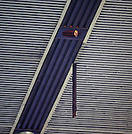 Some cladding is dangling from the roof of the Govan Stand and police have cleared fans from beneath it at half-time