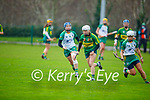 Kerry's Patrice Diggins slips past Meath's Aoife Maguire and Jane Dolan in the Camogie Intermediate Championship