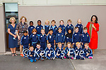 Teachers Terry Landers (back right) and Neasa Ní Lionaird with Annita Horgan-O'Dowd SNA (back left) and the Junior Infants of St Olivers NS Killarney on Wednesday (school doesn't have permission to print kids names)