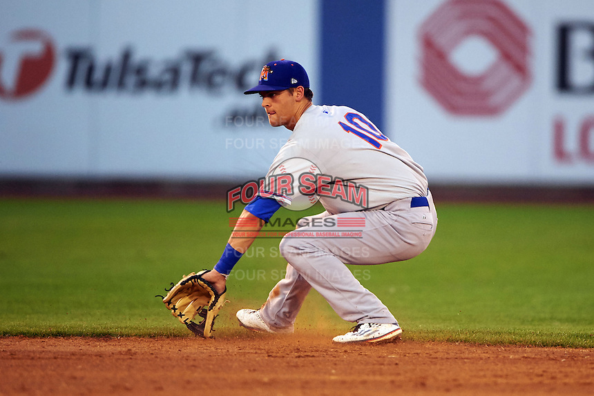 Midland RockHounds shortstop Chad Pinder (2) fields a ground ball during a game against the Tulsa Drillers on June 2, 2015 at Oneok Field in Tulsa, Oklahoma.  Midland defeated Tulsa 6-5.  (Mike Janes/Four Seam Images)
